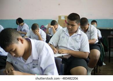 BANGPROK PATHUMTANI THAILAND SEPTEMBER 2016 :Unidentified students are quiz on the exam sheet on September 15,2016 in Bangprok Muang Patumtani Thailand.