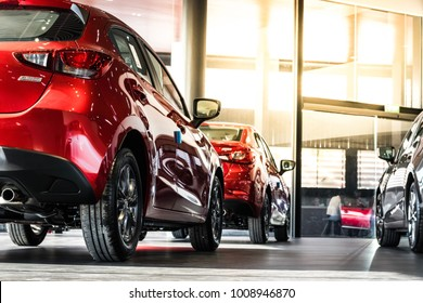 BANGSAEN, THAILAND - JANUARY 14, 2018 :This Car tail light red color all new mazda 2 brand japan red color on blurry backbround parked in showroom of thailand for transport Illustrative editorial