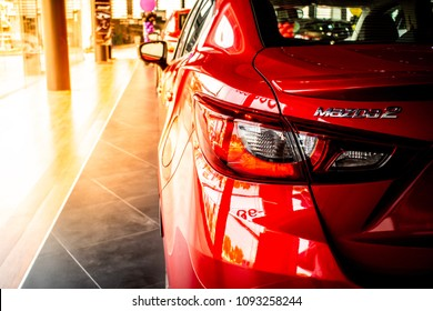 BANGSAEN THAILAND - MAY 2018 :  This Car tail light red color all new mazda 2 brand japan red color close up led Car lights backbround parked in showroom of thailand for customers.