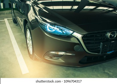 BANGSAEN  THAILAND - MAY, 2018 :  This Front car all new  mazda 2  brand japan red color on room customer backbround parked in showroom of thailand for transport Illustrative editorial image.