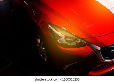 BANGSAEN, THAILAND - MAY, 2018 :  This Front car all new  mazda 2  brand japan red color on room customer backbround parked in showroom of thailand for transport Illustrative editorial image.