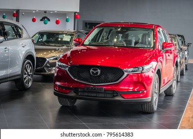 BANGSAN, THAILAND - JANUARY 14, 2018 :  This car all new cx 5 mazda brand japan gray color on room customer backbround parked in showroom of thailand for transport Illustrative editorial image.