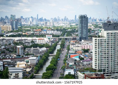 Bangsue, Bangkok/ Thailand - June 14, 2019:  Aerial view of Pracha Chuen Road, Prapa Canal,  Taopoon junction and MRT purple line in Bangsue district. Bangkok's Cityscape.