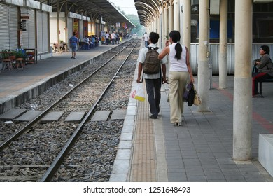Bangsue Train station, Bangkok Thailand, October 10, 2007 : The passengers walk along the railway to the platform which have the baggage on the back with blurred background