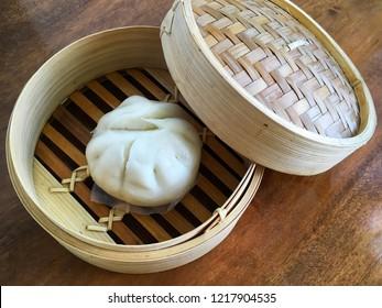 Banh Bao - Vietnamese steam bun in a bamboo steam basket
