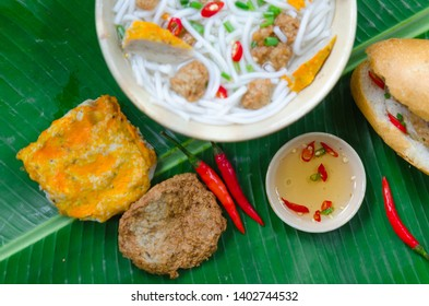 Banh Canh - Rice noodles soup with fried fish ball and Banh Mi Cha Ca - Vietnamese bread with fried fish and chili fish sauce inside. This is a typical combo for breakfast in south central of Vietnam