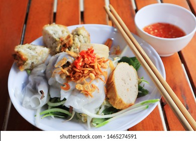 Banh Cuon is a popular northern Vietnamese steamed rice rolls with ground pork and wood ear mushroom serves with sweet chili fish sauce. It usually comes with pork roll and crispy shrimp cake batter
