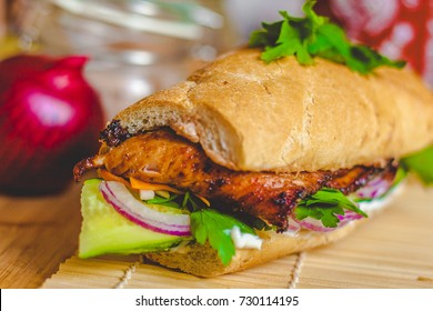 Banh mi vietnamese sandwich with ham, pate, cilantro, and carrot