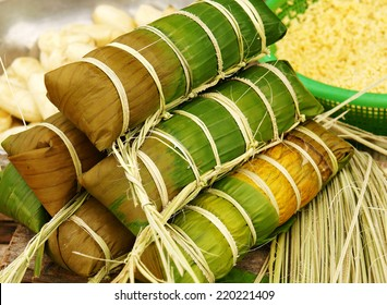 Banh tet for Lunar New Year, Vietnam Tet, food make from glutinous rice, meat, green bean, cover by banana leaf, tie by bamboo rope, is traditional Vietnamese dishes