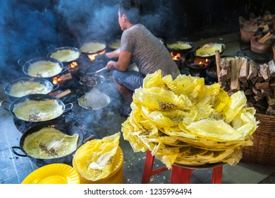 Banh xeo, Vietnamese traditional street food yellow crispy rice flour cake. Sizzling cake, named for the loud sizzling sound it makes when the rice batter is poured into the hot skillet