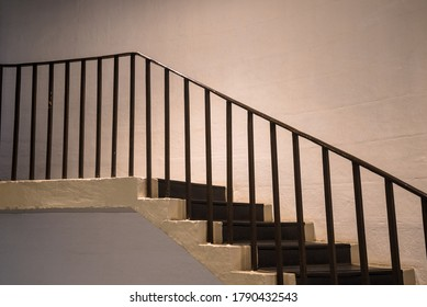 Banister and old stairs in empty building
