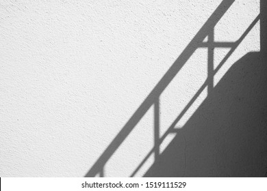 Banister Shadow on White Concrete Wall Texture Background in Minimal Concept.