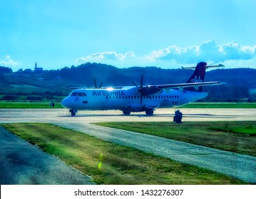 BANJA LUKA, BOSNIA AND HERZEGOVINA, July 12 2017: Air Serbia ATR turbo prop approaching to parking position at International Airport in Banja Luka, Bosnia and Herzegovina.