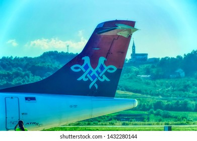 BANJA LUKA, BOSNIA AND HERZEGOVINA, July 12 2017: Air Serbia ATR turbo prop airline back end with tail during parking time at International Airport in Banja Luka, Bosnia and Herzegovina.