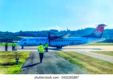 BANJA LUKA, BOSNIA AND HERZEGOVINA, July 12 2017: A ground staff approaching to Air Serbia ATR turbo prop airline during parking time at International Airport in Banja Luka, Bosnia and Herzegovina.