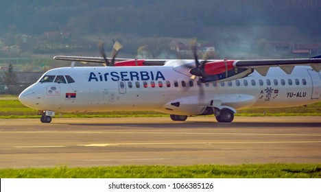 BANJALUKA, BOSNIA AND HERZEGOVINA, April 04 2018: Air Serbia passenger air plane ATR 72 landing on Banja Luka international airport on flight from Belgrade, Serbia.