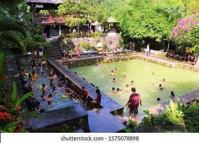 BANJAR, BALI, INDONESIA, ASIA - MARCH 2017: unidentified local people enjoy the hot springs in Banjar, Air Panas, Bali on March 29, 2017.