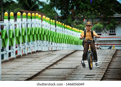 Banjarmasin, Indonesia, 17/11/2012: Indonesian School boy going to school with with a bicycle