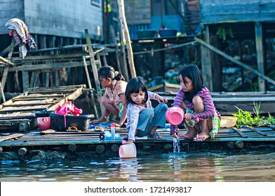Banjarmasin, Indonesia :  Daily activities of residents living on the banks of the Martapura River in Banjarmasin. They use the river for their daily needs, bathing, washing, and so on (07/2011).