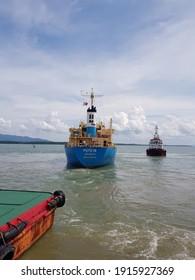 "BANJARMASIN, INDONESIA - Februari 12, 2021: The ""FUYO 18"" coal carriers are preparing to set sail"