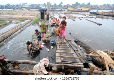 banjarmasin - indonesia january 29 2014: the activities of banjarmasin residents in their daily lives where the river is their daily need
