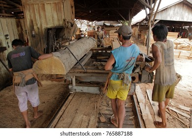 Banjarmasin - Kalimantan Indonesia. the 13th of June 2012. Giant hard wood tree are sawn to small parts for the building industry. Deforestation of the rain forest is a big problem in Indonesia.