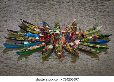 Banjarmasin, South Kalimantan, Indonesia - September 23, 2017 : Women from Lok Baintan (village nearby) having fun at the Jukung Bungas festival 2017 in Banjarmasin