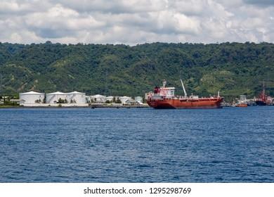 "Banjuwangi, Java, Indonesia - February 9 2015: Singapore Oil Tanker ""OCEAN SUCCESS"" (IMO  9400978, built in 2012) anchoring off Banyuwangi Pertamina oil terminal in the Bali Strait"