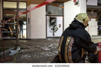 Bank assaulted by criminals they expel an ATM with explosives to steal cash contained in the security safe. Firemen at work after the explosion with the closure area with a safety belt.