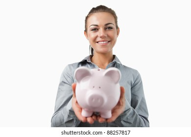 Bank assistant holding piggy bank against a white background