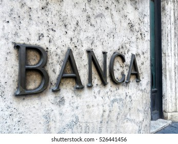 Bank (Banca in italian) entrance with sign on marble wall