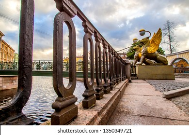 Bank Bridge over the Griboedov Canal.  St. Petersburg. Russia. Bridge with griffins. Griffins of St. Petersburg. Suspension bridge with griffins. Winged lions. Cities of Russia.