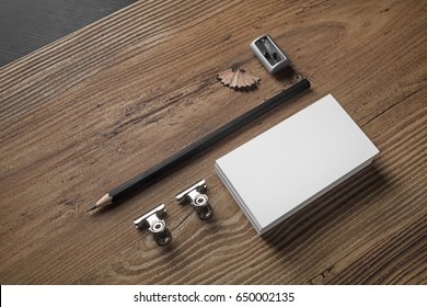Bank business cards, pencil, and sharpener on wood table background. ID template Photo of blank stationery. Mock up for design portfolios.