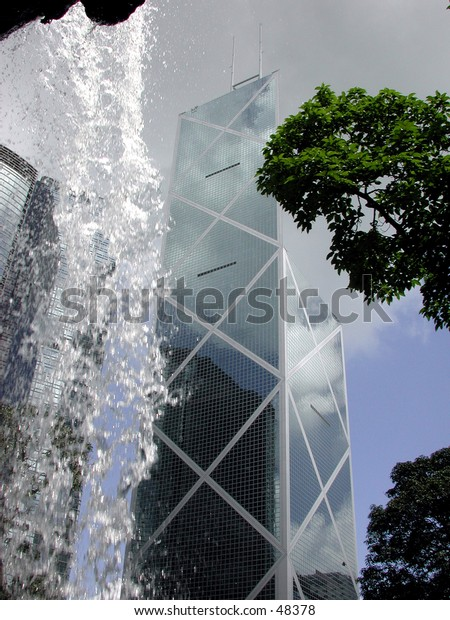 Bank of China building in Hong Kong taken from behind a waterfall in a nearby park.