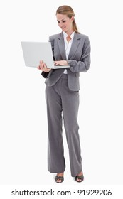 Bank employee with laptop against a white background