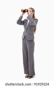 Bank employee looking through binoculars against a white background