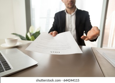 Bank employee offers to read and check loan agreement form. Financial consultant advises to take loan on business purpose, new house buying. Company partner invites to sign mortgage contract. Close up