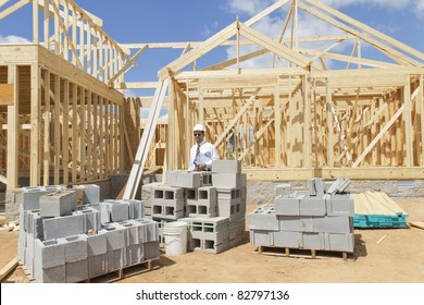 Bank finance personal inspecting new home that is under construction, his company financed the builder