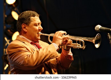 BANK, HUNGARY - JUNE 27: Herbert Christ plays at trumpet during the 5th Louis Amstrong Jazz Festival on June 27, 2008 in Bank, Hungary