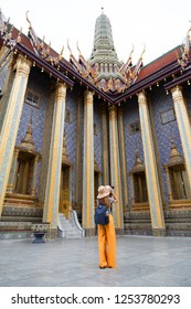 BANK KOK, THAILAND - NOV 8, 2018; Tourist girl Walking to  Wat Phra Kaew, the Temple of the Emerald Buddha, and the adjoining Grand Palace together form the greatest spectacle for the visitor.