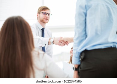 Bank Manager and the customer shake hands after signing a lucrative contract