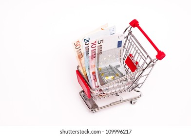 Bank notes in a cart on a white background