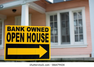 Bank Owned Open House. In Front of a Home