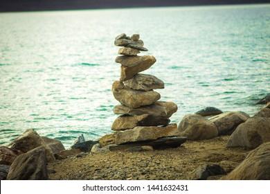 bank of pngong lake,stones for goodluck