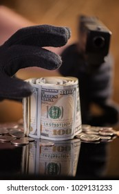 bank robbery money thief stealing american dollars armed robbery
