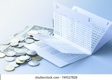 Bank saving deposit account and cash in blue