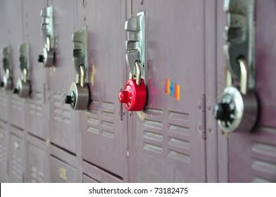 Bank of school lockers with combination locks.