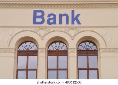 Bank sign above entrance on building
