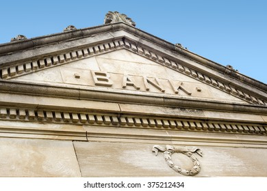 Bank sign on a old stone bank building exterior