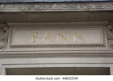Bank Sign on Stone Facade